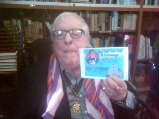Ray Bradbury showing off his new Shel Dorf Fan Club badge (photo courtesy of Greg Koudoulian)