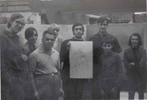 From left to right: Richard Alf, Wayne Kincaid, Jack King Kirby, Mike Towry (in back), Dan Stewart, Bob Sourk, Barry Alfonso (in front), and Sylvia Alfonso. Picture taken on November 9, 1969 at the Kirby-family home in Irvine, California.