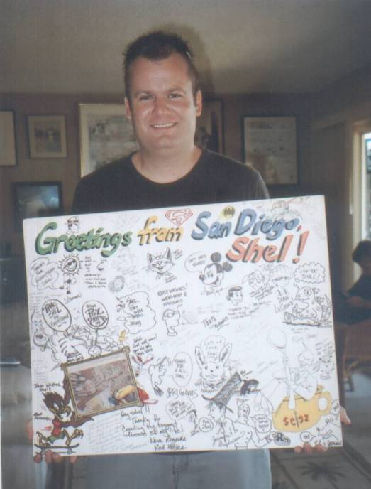 Matt Lorentz holds giant greeting card for Shel Dorf created at Comic-Con 2009 by many artist contributors.